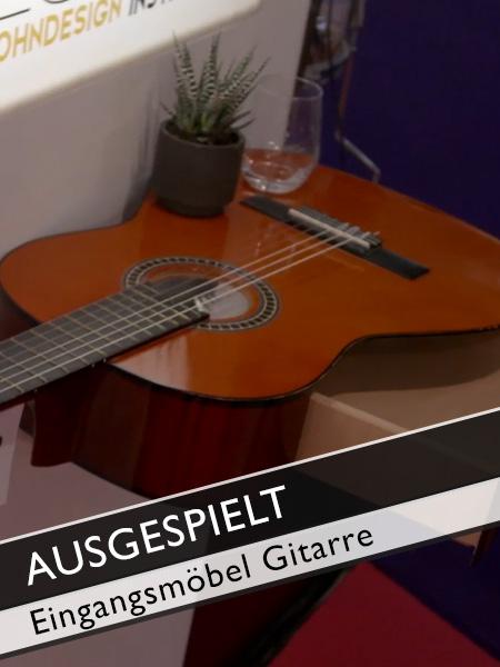 Ausgespielt Gitarre als Eingangsmöbel